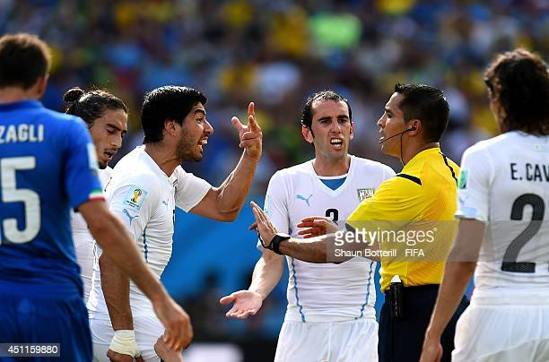 Luis Suarez and Diego Godin of Uruguay appeals to referee Marco Rodriguez during the 2014 FIFA World Cup Brazil Group D match between Italy and...