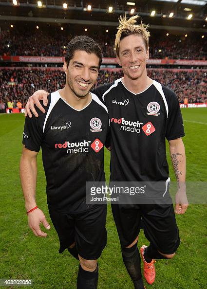 Luis Suarez and Fernando Torres walk around the pitch at the end of the Liverpool All Star Charity Match at Anfield on March 29 2015 in Liverpool...
