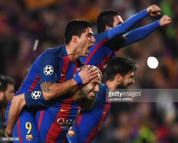 Luis Suarez and Javier Mascherano of Barcelona celebrate victory after the UEFA Champions League Round of 16 second leg match between FC Barcelona...