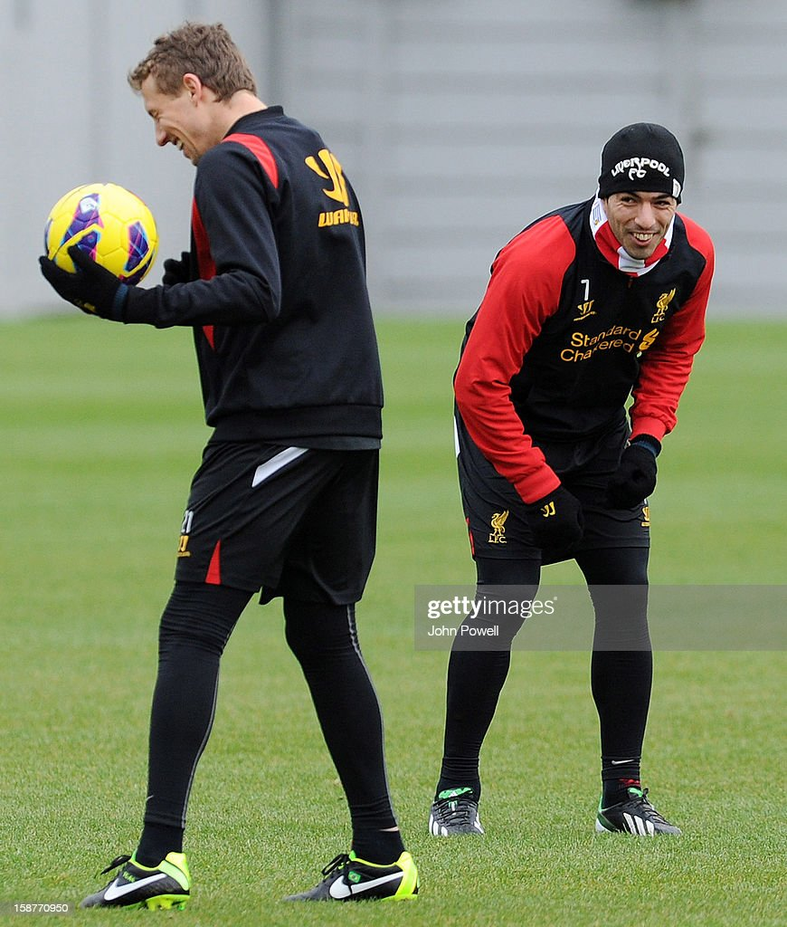 Luis Suarez and Lucas Leiva of Liverpool in action during a training session at Melwood Training Ground on December 28, 2012 in Liverpool, England.