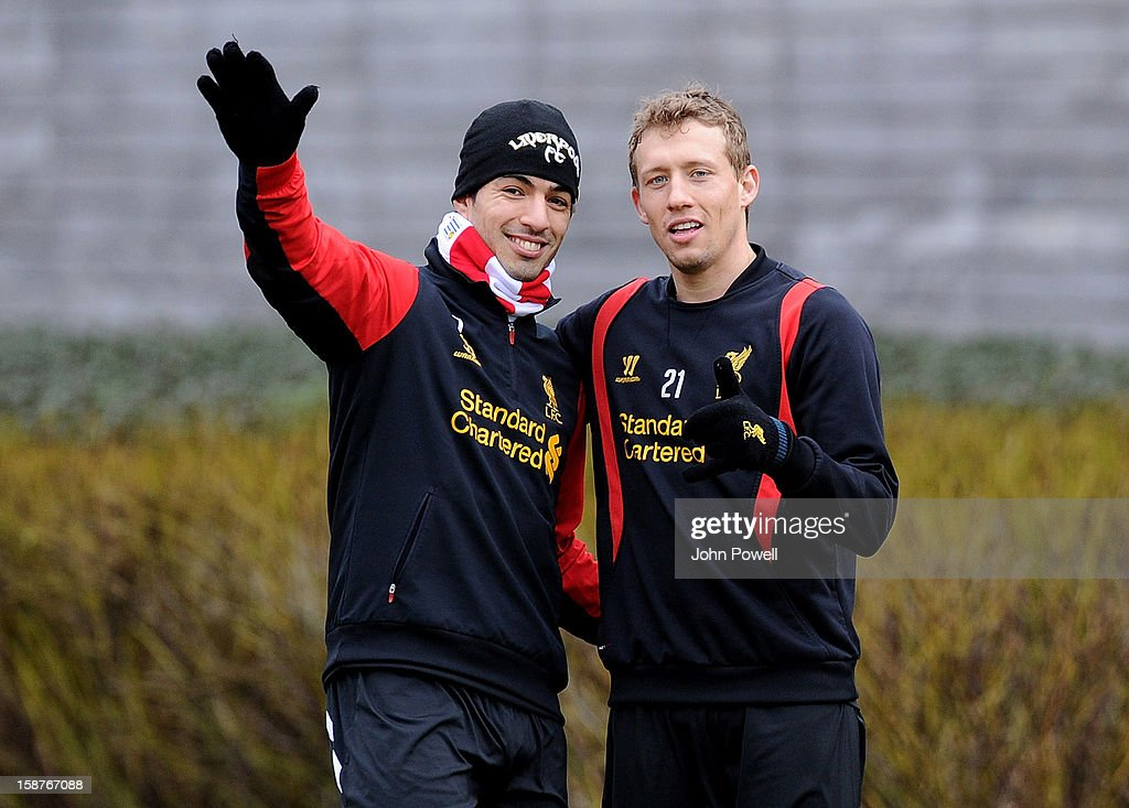 Luis Suarez and Lucas Leiva of Liverpool pose during a training session at Melwood Training Ground on December 28, 2012 in Liverpool, England.
