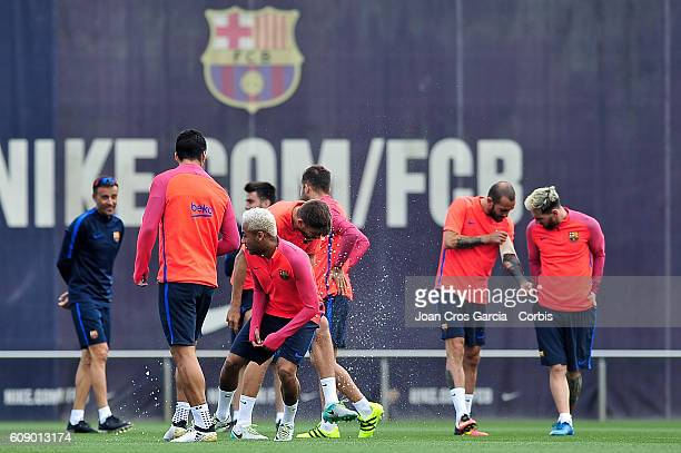Luis Suarez and Neymar Jr of FC Barcelona attend a training session at the Sports Center FC Barcelona Joan Gamper before the Spanish League match...