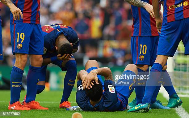 Luis Suarez and Neymar JR of FC Barcelona impacts a bottle during the La Liga match between Valencia CF vs FC Barcelona at Mestalla Stadium Valencia...