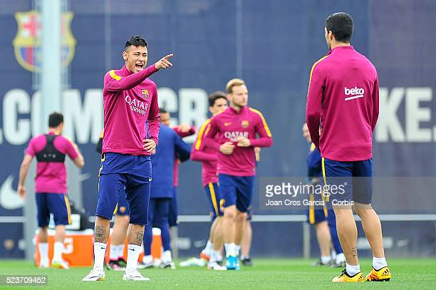 Luis Suarez and Neymar Jr of FC Barcelona jogging during the FCBarcelona training session on April 22 2016 in Barcelona Spain