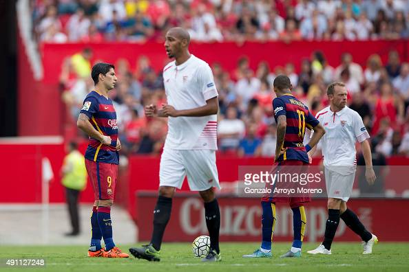 Luis Suarez and Neymar JR of FC Barcelona reacts as Steven N'Kemboanza Mike Christopher N'Zonzi and Michael KrohnDehli of Sevilla FC celebrate his...