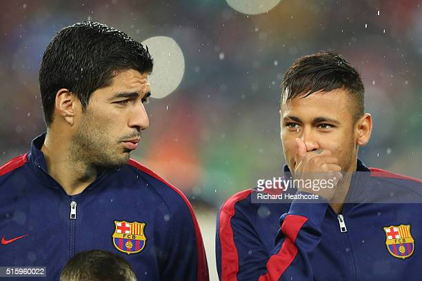 Luis Suarez and Neymar of Barcelona look on prior to the UEFA Champions League round of 16 second Leg match between FC Barcelona and Arsenal FC at...