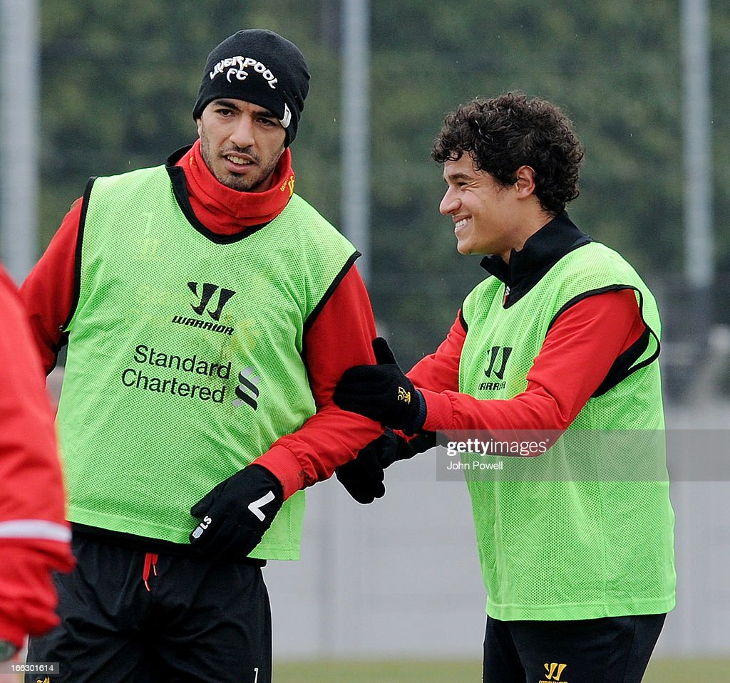 Luis Suarez and Philippe Coutinho of Liverpool in action during a training session at Melwood Training Ground on April 11, 2013 in Liverpool, England.