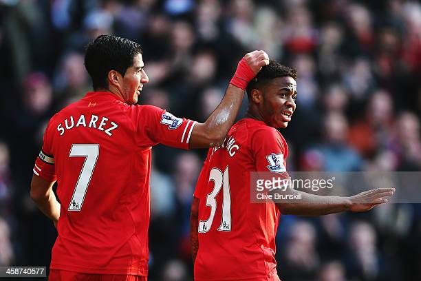Luis Suarez and Raheem Sterling of Liverpool react during the Barclays Premier League match between Liverpool and Cardiff City at Anfield on December...