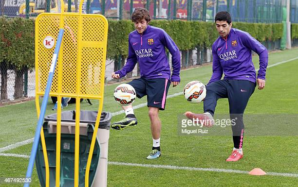 Luis Suarez and Sergi Roberto attempt to 'score' in a bin during the FC Barcelona training session at Ciutat Esportiva on March 25 2015 in Barcelona...