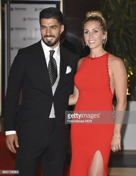 Luis Suarez and Sofia Balbi attend Lionel Messi and Antonela Rocccuzzo's wedding at the City Center Rosario Hotel Casino on June 30 2017 in Rosario...