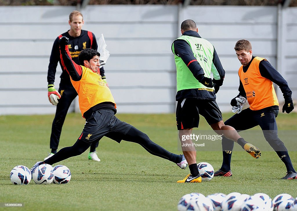 Luis Suarez and <a gi-track='captionPersonalityLinkClicked' href=/galleries/search?phrase=Steven+Gerrard&family=editorial&specificpeople=202052 ng-click='$event.stopPropagation()'>Steven Gerrard</a> of Liverpool in action during a training session at Melwood Training Ground on March 14, 2013 in Liverpool, England.