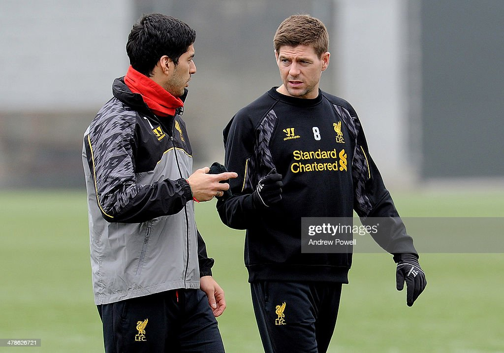 Luis Suarez and <a gi-track='captionPersonalityLinkClicked' href=/galleries/search?phrase=Steven+Gerrard&family=editorial&specificpeople=202052 ng-click='$event.stopPropagation()'>Steven Gerrard</a> of Liverpool talking during a training session at Melwood Training Ground on March 14, 2014 in Liverpool, England.