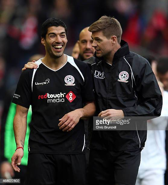 Luis Suarez and Steven Gerrard of the Gerrard XI share a laugh at full time following the Liverpool AllStar Charity match at Anfield on March 29 2015...