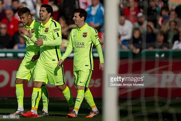 Luis Suarez celebrates scoring their second goal with team mates Neymar JR and Lionel Messi during the La Liga match between Granada CF and FC...