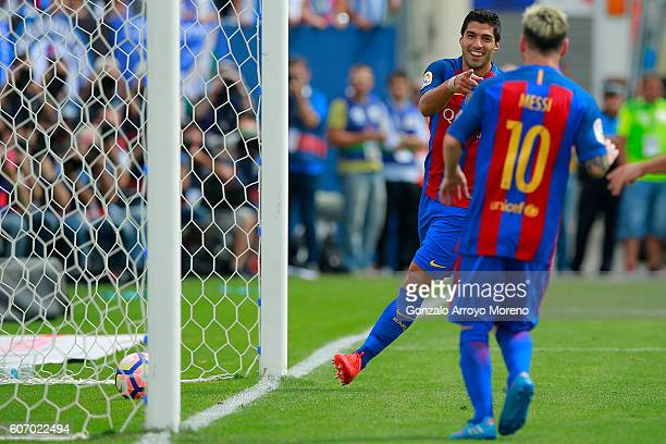 Luis Suarez celebrates scoring their second goal with teammate Lionel Messi during the La Liga match between Deportivo Leganes and FC Barcelona at...