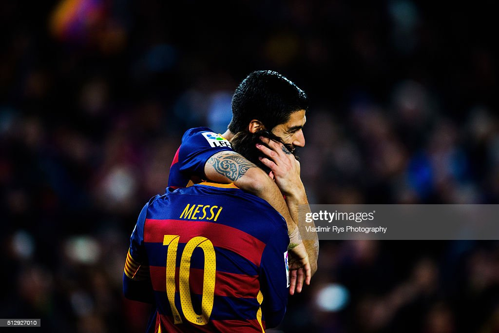 Luis Suarez celebrates with his team mate Lionel Messi of Barcelona their team's second goal during the La Liga match between FC Barcelona and Sevilla FC at Camp Nou on February 28, 2016 in Barcelona, Spain.