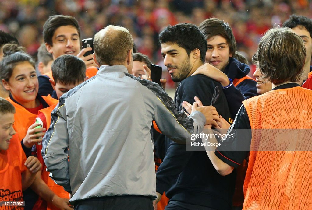 Luis Suarez (C) is mobbed by Liverpool fans during a Liverpool FC training session at Melbourne Cricket Ground on July 23, 2013 in Melbourne, Australia.