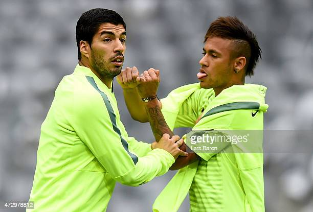 Luis Suarez jokes with Neymar during a FC Barcelona training session on the eve of the UEFA Champions League semi final second leg match against FC...