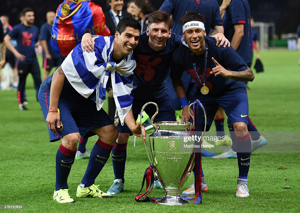 Luis Suarez Lionel Messi and Neymar of Barcelona celebrate with the trophy after the UEFA Champions League Final between Juventus and FC Barcelona at...
