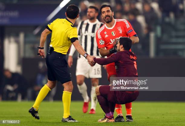 Luis Suarez of Barcelona and Gianluigi Buffon of Juventusin looks on during the UEFA Champions League group D match between Juventus and FC Barcelona...