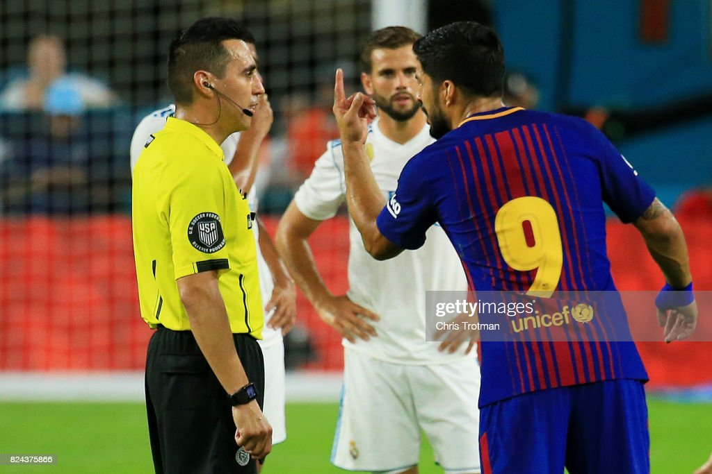 Luis Suarez #9 of Barcelona argues a call during their International Champions Cup 2017 match against Real Madrid at Hard Rock Stadium on July 29, 2017 in Miami Gardens, Florida.