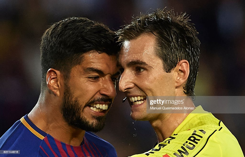 Luis Suarez of Barcelona argues with the referee Ricardo de Burgos Bengotxea during the Supercopa de Espana Supercopa Final 1st Leg match between FC Barcelona and Real Madrid at Camp Nou on August 13, 2017 in Barcelona, Spain.