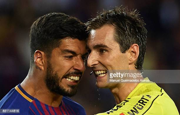 Luis Suarez of Barcelona argues with the referee Ricardo de Burgos Bengotxea during the Supercopa de Espana Supercopa Final 1st Leg match between FC...