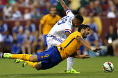 Luis Suarez of Barcelona battles with Kenedy of Chelsea for the ball in the first half during the International Champions Cup North America at...
