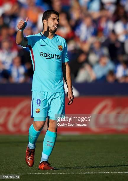 Luis Suarez of Barcelona celebrates after scoring the first goal during the La Liga match between Leganes and Barcelona at Estadio Municipal de...