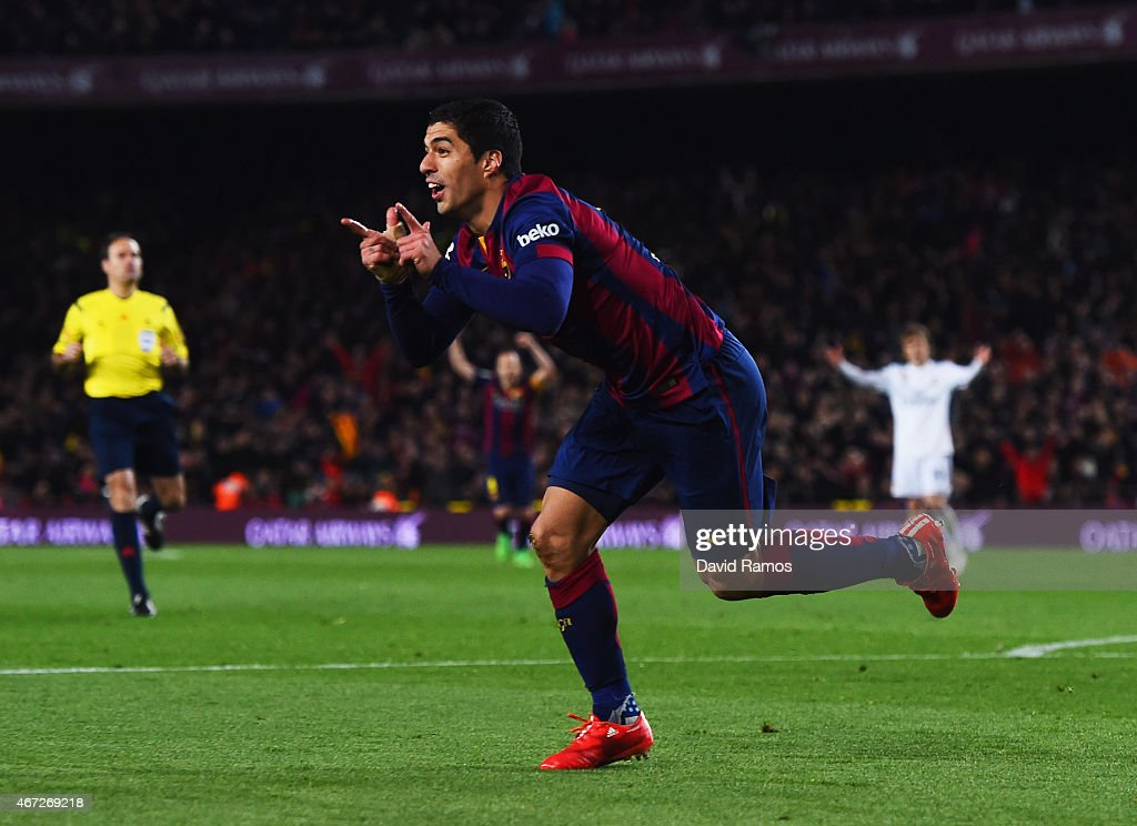 Luis Suarez of Barcelona celebrates as he scores their second goal during the La Liga match between FC Barcelona and Real Madrid CF at Camp Nou on March 22, 2015 in Barcelona, Spain.
