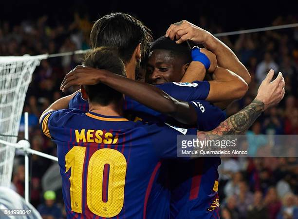 Luis Suarez of Barcelona celebrates scoring his team's fifth goal with his teammates Lionel Messi Ousmane Dembele and Andre Gomes during the La Liga...