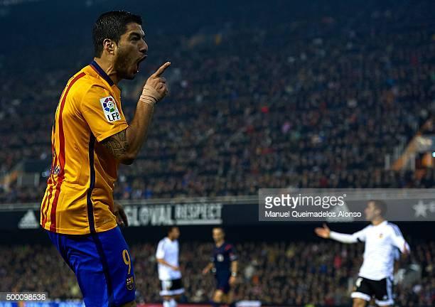 Luis Suarez of Barcelona celebrates scoring his team's first goal during the La Liga match between Valencia CF and FC Barcelona at Estadi de Mestalla...