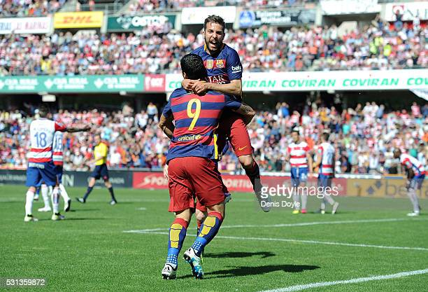 Luis Suarez of Barcelona celebrates scoring his team's first goal with his team mate Jordi Alba during the La Liga match between Granada and...
