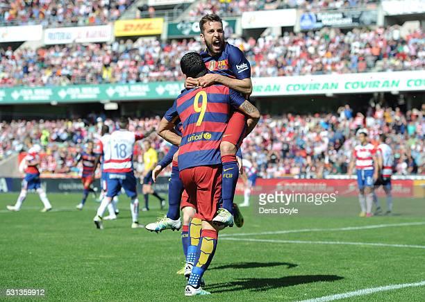 Luis Suarez of Barcelona celebrates scoring his team's first goal with his team mate Jordi Alba during the La Liga match between Granada and...