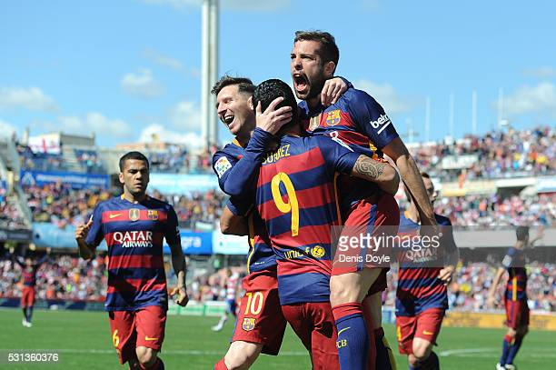 Luis Suarez of Barcelona celebrates scoring his team's first goal with his team mates during the La Liga match between Granada and Barcelona at...