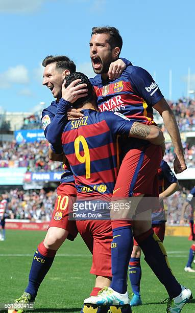 Luis Suarez of Barcelona celebrates scoring his team's first goal with his team mates Jordi Alba and Lionel Messi during the La Liga match between...