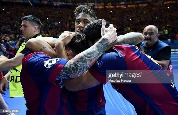 Luis Suarez of Barcelona celebrates scoring his team's second goal with Neymar and Lionel Messi of Barcelona during the UEFA Champions League Final...
