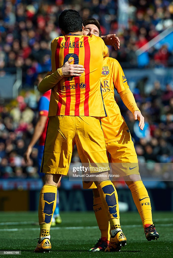 Luis Suarez of Barcelona celebrates scoring his team's second goal with his teammate <a gi-track='captionPersonalityLinkClicked' href=/galleries/search?phrase=Lionel+Messi&family=editorial&specificpeople=453305 ng-click='$event.stopPropagation()'>Lionel Messi</a> during the La Liga match between Levante UD and FC Barcelona at Ciutat de Valencia on February 07, 2016 in Valencia, Spain.