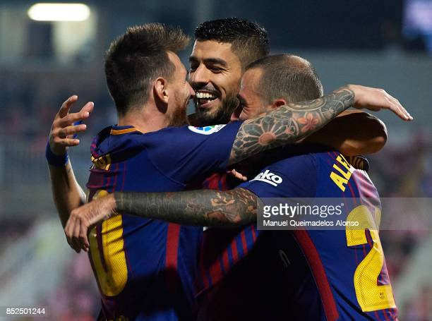 Luis Suarez of Barcelona celebrates scoring his team's second goal with his teammates Aleix Vidal and Lionel Messi during the La Liga match between...