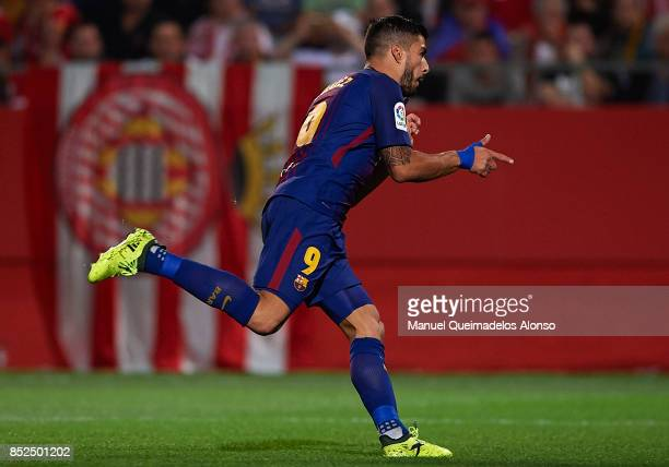 Luis Suarez of Barcelona celebrates scoring his team's third goal during the La Liga match between Girona and Barcelona at Municipal de Montilivi...