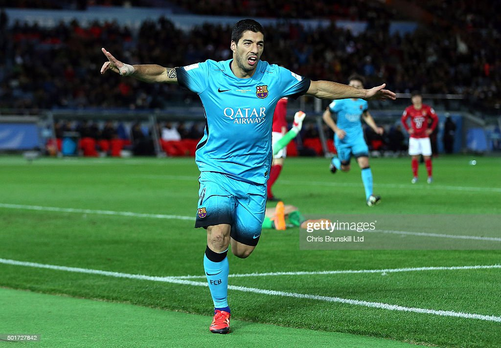 Luis Suarez of Barcelona celebrates scoring the opening goal during the FIFA Club World Cup Semi Final match between Barcelona and Guangzhou...