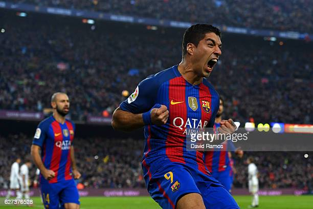 Luis Suarez of Barcelona celebrates scoring the opening goal during the La Liga match between FC Barcelona and Real Madrid CF at Camp Nou on December...