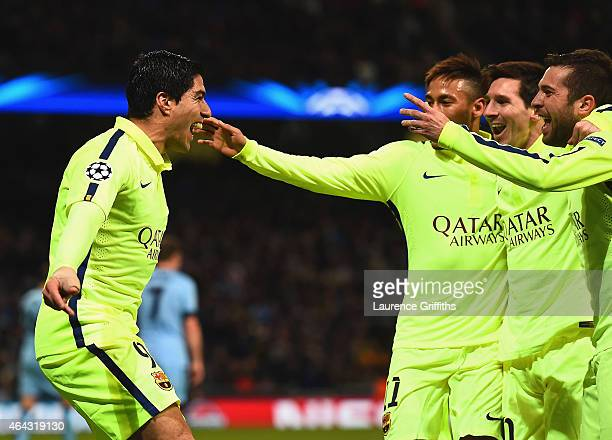 Luis Suarez of Barcelona celebrates scoring their second goal with team mates during the UEFA Champions League Round of 16 match between Manchester...