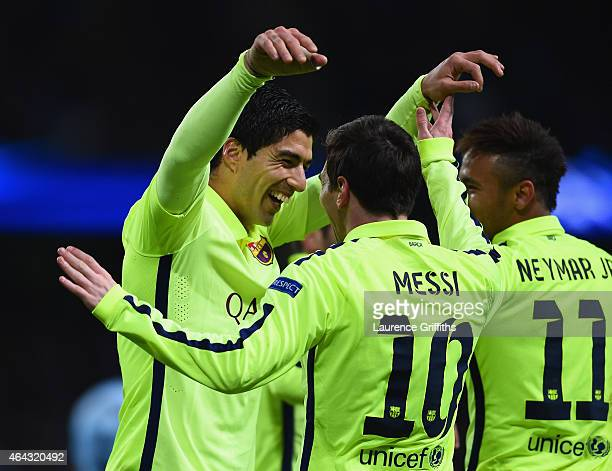 Luis Suarez of Barcelona celebrates scoring their second goal with Lionel Messi and Neymar of Barcelona during the UEFA Champions League Round of 16...