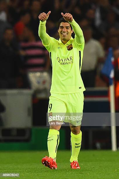 Luis Suarez of Barcelona celebrates scoring their third goal during the UEFA Champions League Quarter Final First Leg match between Paris...