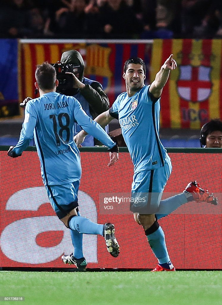 Luis Suarez of Barcelona celebrates with team mates after scoring his team's second goal during the FIFA Club World Cup Semi Final match between...
