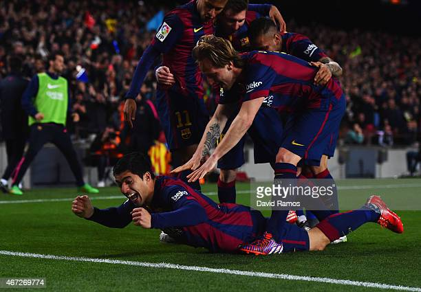 Luis Suarez of Barcelona celebrates with team mates as he scores their second goal during the La Liga match between FC Barcelona and Real Madrid CF...
