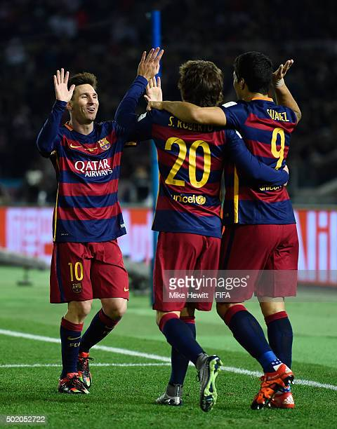 Luis Suarez of Barcelona celebrates with teammates Lionel Messi and Sergi Roberto of Barcelona after scoring his team's third goal during the FIFA...