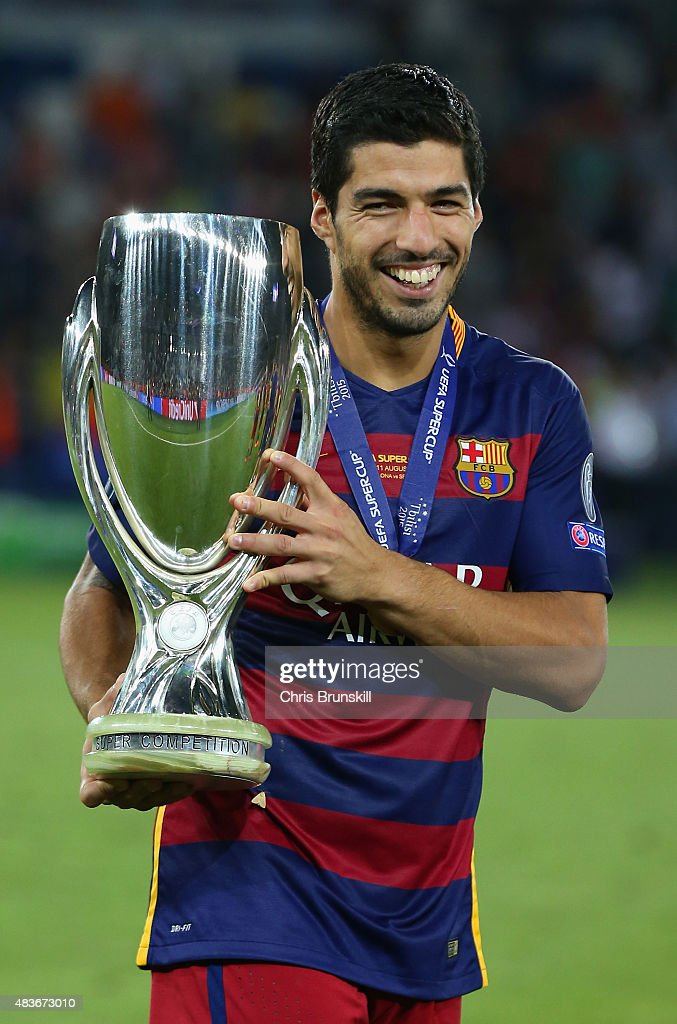 Luis Suarez of Barcelona celebrates with the UEFA Super Cup after the UEFA Super Cup between Barcelona and Sevilla FC at Dinamo Arena on August 11, 2015 in Tbilisi, Georgia.
