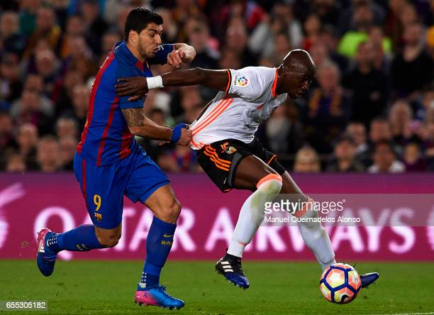 Luis Suarez of Barcelona competes for the ball with Eliaquim Mangala of Valencia during the La Liga match between FC Barcelona and Valencia CF at...